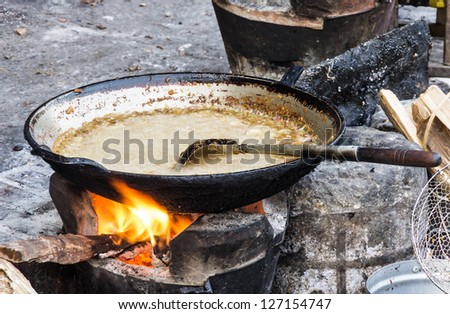 Frying Pan with sauce - Street food in Laos - stock photo