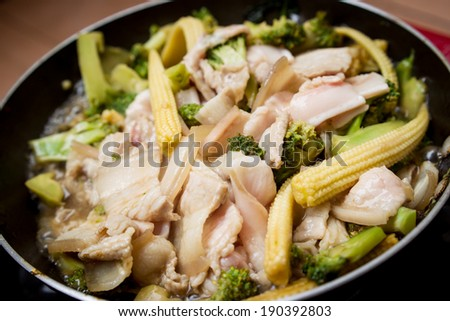 Frying vegetable in a pan. - stock photo