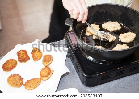 frying vegetarian cutlets from lentil on frying pan - stock photo