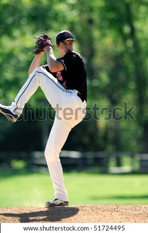 FT. WASHINGTON, PA - APRIL 23: Germantown Academy pitcher Keenan Kish prepares to the throw a pitch in a game against rival Malvern Prep on April 23, 2010 in Ft. Washington, PA. - stock photo