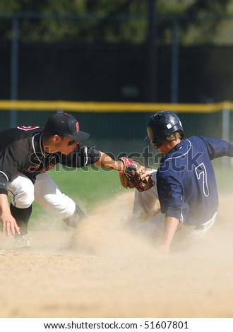 FT. WASHINGTON, PA - APRIL 23: Germantown Academy shortstop Sean Coyle tries to tag Malvern's Drew Hayes on a stolen base attempt in a rivalry  game on April 23, 2010 in Ft. Washington, PA - stock photo