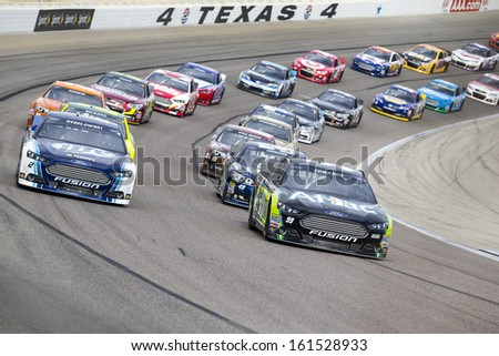 Ft Worth, TX - Nov 03, 2013:  The NASCAR Sprint Cup teams take to the track for the AAA Texas 500 race at the Texas Motor Speedway in Ft Worth, TX on Nov 03, 2013. - stock photo