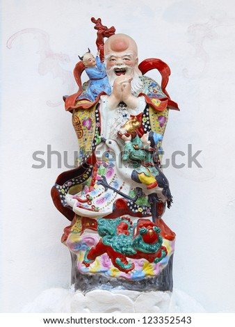 Fu Lu Shou statues in Chinese Shrine. - stock photo