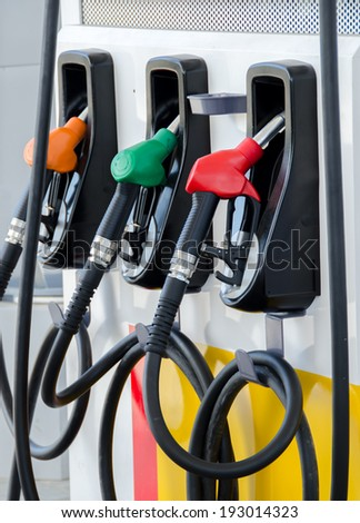Fuel dispenser at a gasoline station - stock photo