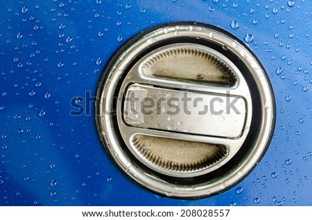 Fuel Gas Cap on the blue field, Texture Background. - stock photo