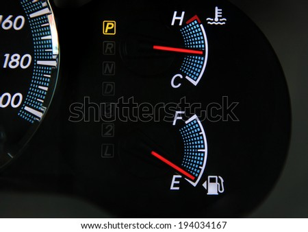 Fuel gauge dash board close up an instrument panel in the dashboard of an automobile. - stock photo