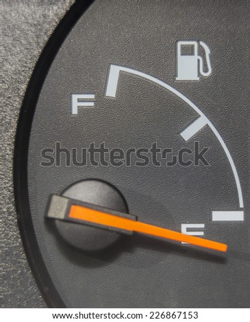 Fuel gauge dash board close up showing empty - stock photo