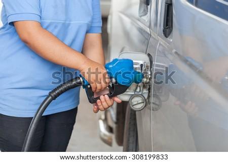 Fuel nozzle at a car service. - stock photo