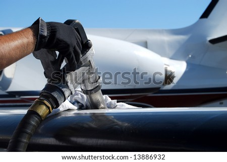 Airplane Fueling Stock Photos, Illustrations, and Vector Art