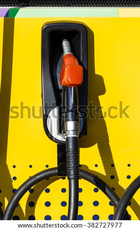 Fuel nozzle in petrol station. Close up shot. - stock photo