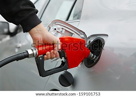 Fuel nozzle with hose isolated on white background - stock photo