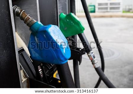 Fuel oil dispenser at petrol filling station. - stock photo