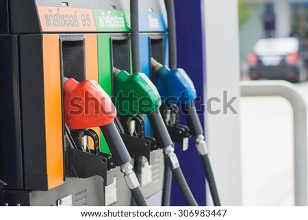 fuel oil gasoline dispenser at petrol filling station - stock photo