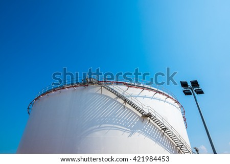 Fuel oil storage tank in power plant - stock photo