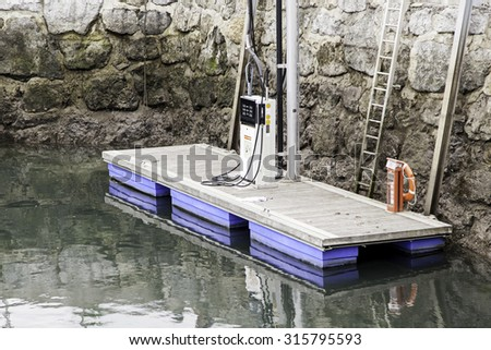 Fuel pump at sea, detail of a gas in water - stock photo