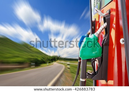 Fuel pump on road. - stock photo