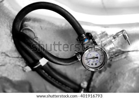 Fuel regulator gauge with fuel tube - stock photo