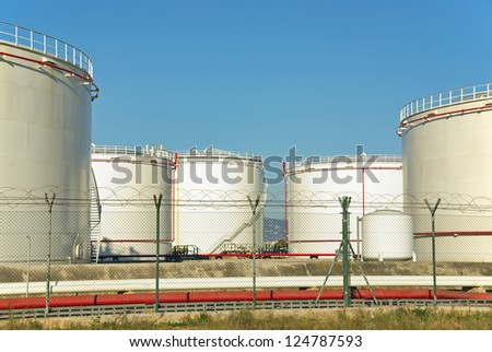 Fuel Storage plant with big tanks used to store oil - stock photo
