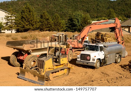 Fuel truck on its morning fueling of the equipment on a new commercial development construction project. - stock photo