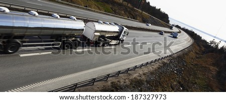 fuel-truck on the move, panoramic and elevated perspective, truck is slightly blurred - stock photo