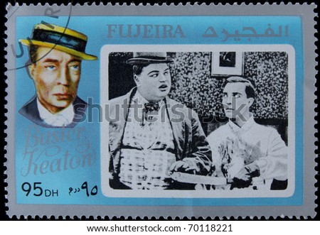 FUJEIRA-CIRCA 1990: A post stamp printed in Fujeira shows portrait of Buster Keaton,American comic actor and filmmaker. circa 1990 - stock photo