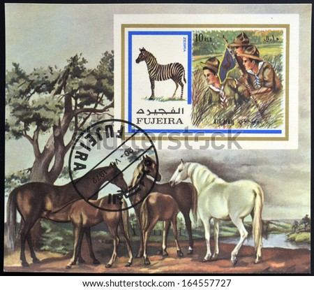 FUJEIRA - CIRCA 1972: A stamp printed in Fujeira shows boy scouts and zebra, circa 1972  - stock photo