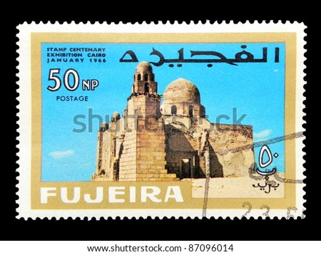 "FUJEIRA - CIRCA 1966: A stamp printed in Fujeira (UAE) shows First Christian church with inscription and name of the series ""Stamp Centenary Exhibition, Cairo, January 1966"", circa 1966 - stock photo"