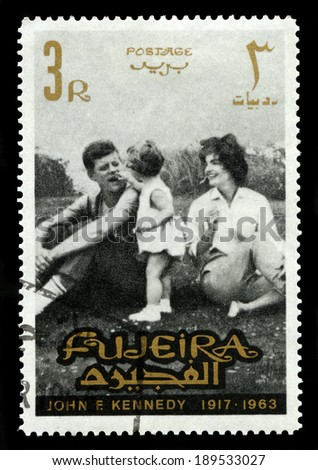 FUJEIRA, CIRCA 1965: A vintage Postage Stamp from Fujeira featuring an image of former President of the United States John F. Kennedy and his family, circa 1965. - stock photo