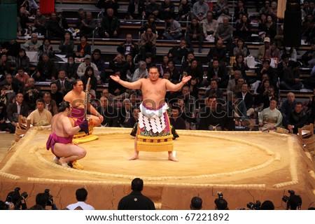 FUKUOKA - NOVEMBER 18: Three highest ranking sumo wrestlers performing a ceremony in the Fukuoka Tournament on November 18, 2010 in Fukuoka, Japan. - stock photo