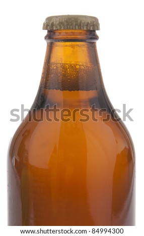 Full beer bottle with no labels isolated on white - stock photo
