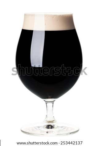 Full beer tulip glass of stout or porter isolated on white background - stock photo