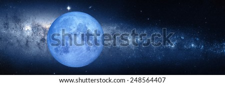 "Full blue moon with star at dark night ""Elements of this image furnished by NASA ""  - stock photo"