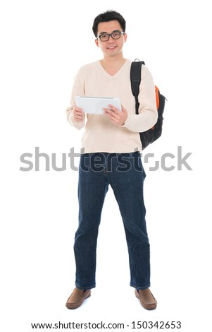 Full body Asian adult student in casual wear  using digital computer tablet pc standing isolated on white background. Asian male model. - stock photo