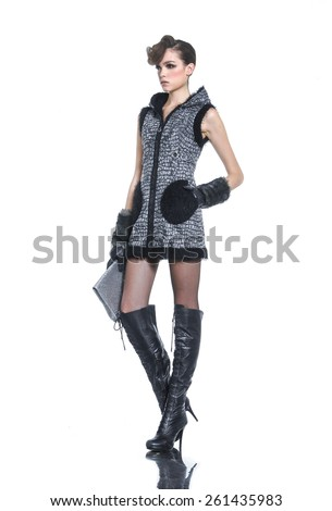 Full body beautiful high fashion model in modern clothes hold purse posing - stock photo