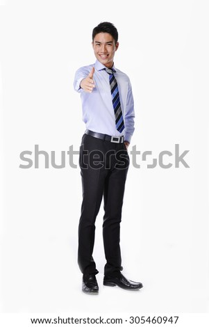 Full body businessman pressing an imaginary button - stock photo