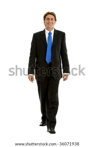 Full body businessman walking towards the camera isolated - stock photo