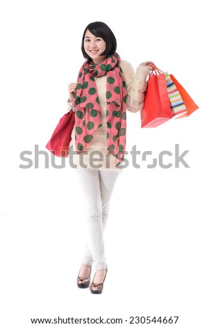 Full body Cheerful young woman holding shopping bags - stock photo