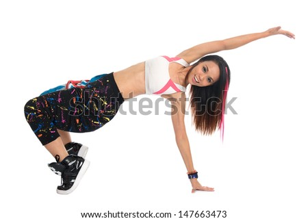 Full body cool looking girl dances jazz modern dance isolated on white background. Asian youth culture. - stock photo