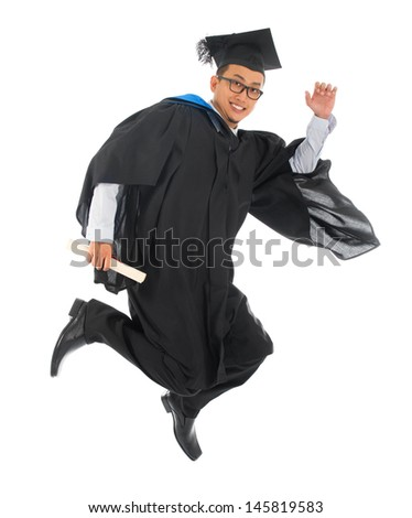 Full body excited Asian male university student in graduation gown jumping high or running isolated on white background - stock photo