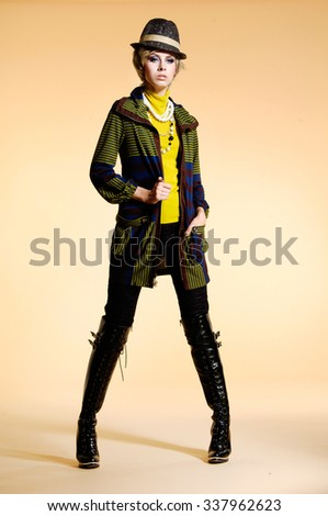 Full body fashion model in fashion dress with hat posing  - stock photo