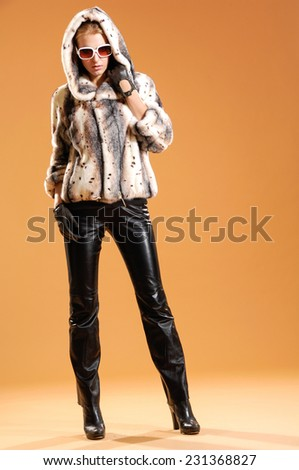 Full body fashion model In sunglasses posing in the studio  - stock photo