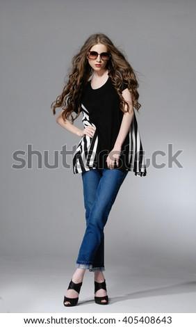 Full body fashion model wearing sunglasses posing - stock photo