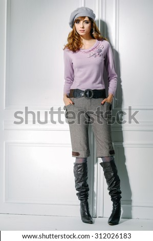 Full body fashion shot of girl posing in studio - stock photo