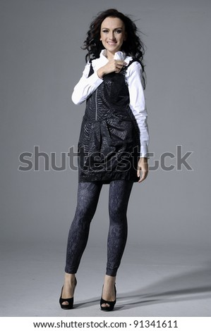 Full body happy smiling business woman in suit isolated - stock photo
