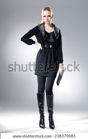 Full body High fashion model holding little purse posing  - stock photo