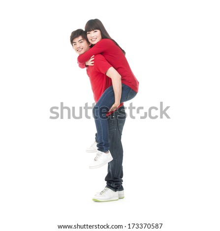 Full body man carrying girlfriend on his back - stock photo