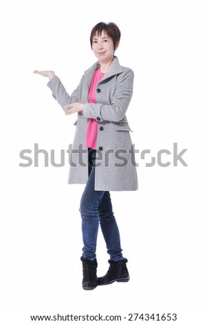 Full body Middle aged corporate woman showing copy space to the camera, smiling warmly. - stock photo