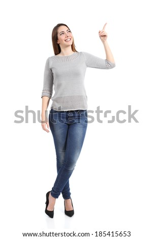 Full body of a standing casual woman pointing at side isolated on a white background               - stock photo