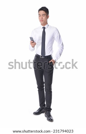 Full body of a young Asian business man using smart phone - stock photo