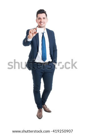 Full body of cheerful young businessman showing blank business or visit card with copyspace isolated on white background - stock photo